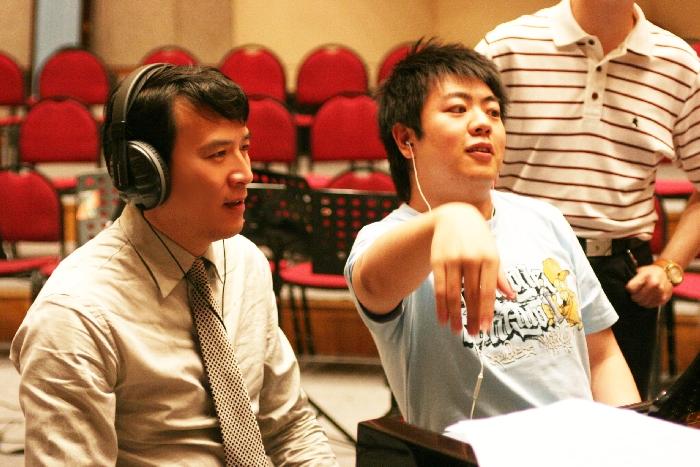 Xiaogang_Ye_Rehearsing_Grand_Theater_Overture_with_Seiji_Ozawa_Beijing.jpg